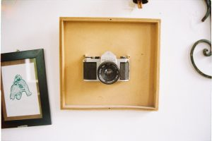 white and black camera inside a wooden frame